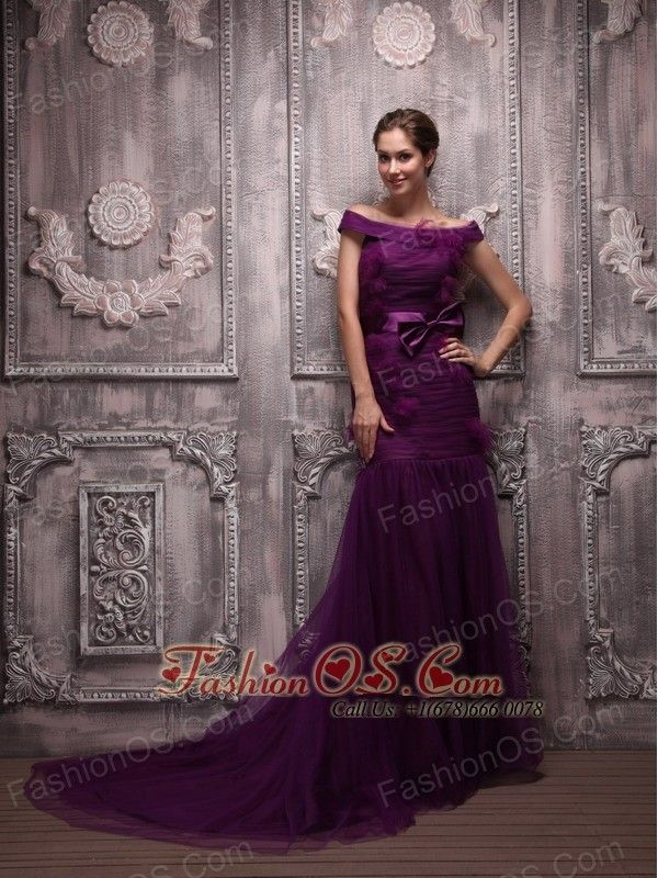 Purple Mermaid Off The Shoulder with Hand Made Flowers Mother of the Bride Dress- $163.59http://www.fashionos.com  http://www.facebook.com/quinceaneradress.fashionos.us  Prom night is meant to be special and in this gorgeous gown, you can be sure it will be. It's made in a sheath style with a off shouder neckline and an elegant ruched pattern throughout. T