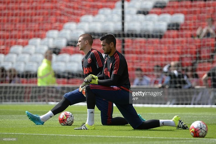 Manchester United's Argentinian goalkeeper Sergio Romero (R) and Manchester United's English goalkeeper Sam Johnstone (L) warm up before the match