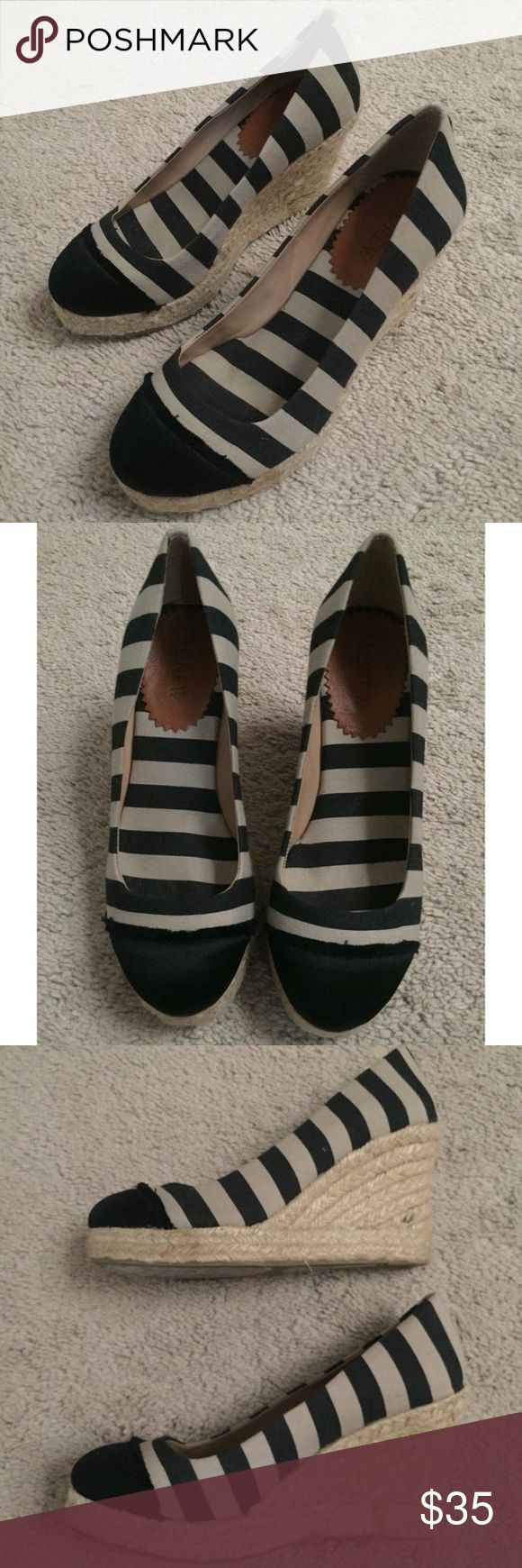 """J. Crew Seville Striped Nautical Espadrille Wedges J. Crew Seville Navy Striped Nautical Espadrille Wedges   • Size: 5  • Color: Navy and Beige  • Canvas Lining  • Leather upper  • 3.5"""" heel (High), Medium width  • Slip on style/ fastening  • Striped pattern/ Nautical theme  • In excellent pre-owned condition. Small black stain on the right platform only. Please refer to pics for more detailed condition. Does not come in box  No trades.   Bundle and save.   Comment for questions. J. Crew…"""