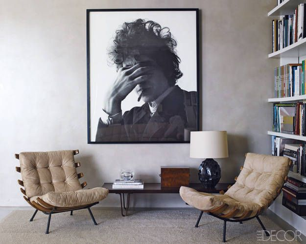 Theory's Andrew Rosen and Jenny Dyer's Home : A pair of '60s Brazilian chairs and a photograph of Bob Dylan by Jerry Schatzberg in the living area.