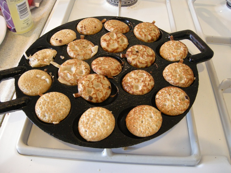 Traditional Dutch Food: Poffertjes, eaten with iced suger and butter.