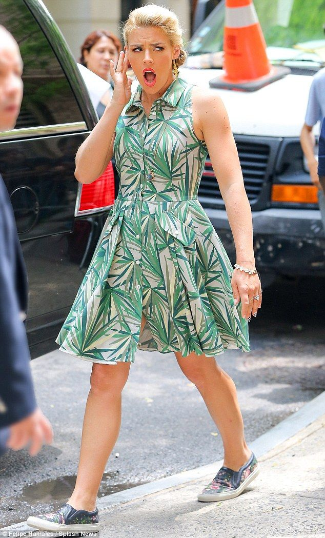 Sizzling style: Busy Philipps cut a cool figure in a retro-inspired ensemble on Monday, as...