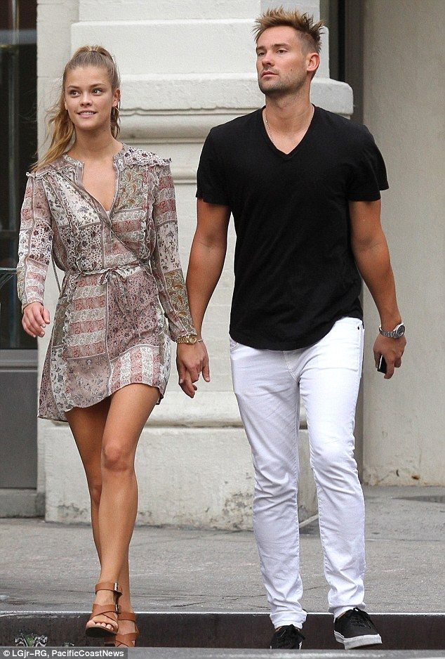 Going strong: Nina Agdal and Reid Heidenry strolled hand-in-hand on Saturday in the SoHo n...