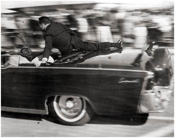 Clint Hill on the limousine. This Day in History: Nov 22, 1963: John F. Kennedy assassinated