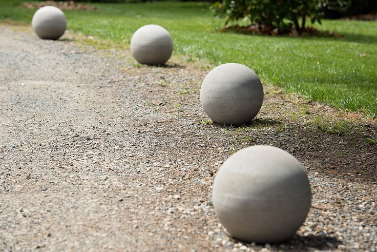 stone spheres...or bollards as design features on a sweeping driveway
