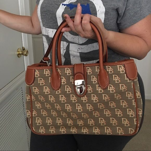 Dooney and Bourke Purse ⬇️ Price Drop ⬇️ Dooney and Bourke Tote Absolutely Stunning Purse ✨Brand New✨NeverWorn (NWOT)✨ This is an authentic Dooney & Bourke purse that has been sitting in my closet for a couple of years, in other words, has zero imperfections, no pen marks, no stains.  NEW DOONEY & BOURKE  No Trades  PP and please no lowballing! Bags Totes