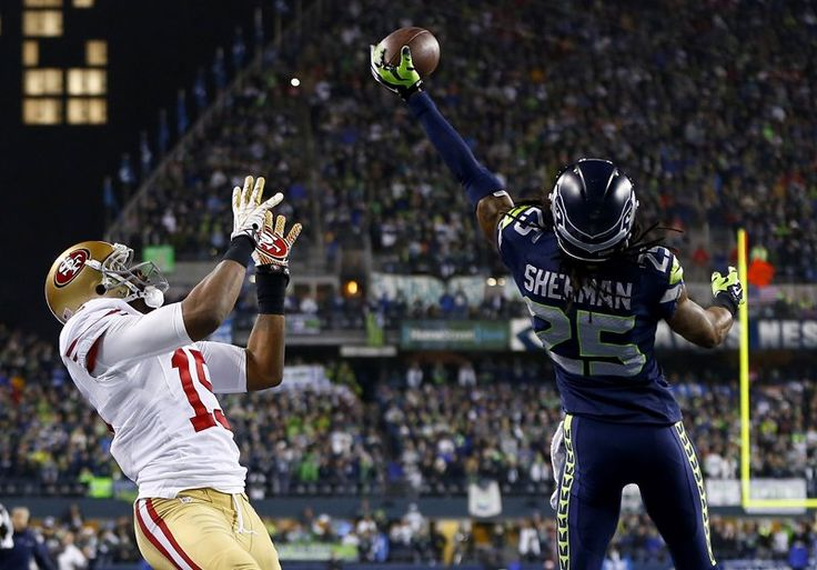 Richard Sherman #25 (CB) assists in the game winning interception taking the Seahawks to the Superbowl. Pictured Michael Crabtree #15 (WR). 1/19/14