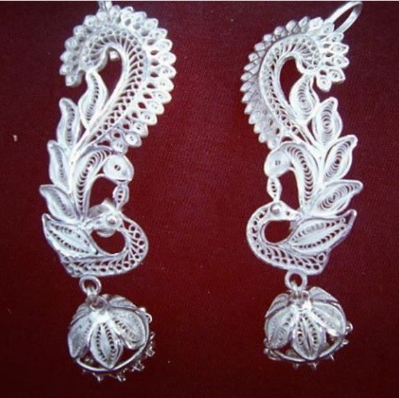 PEACOCK SILVER FILIGREE EARRINGS ER002:  This peacock shaped ear ring is an excellent example of the intricate silver filigree work.  This ear ring can be worn with Ethic wear.  This is an integral part of Odissi Dance Ornaments.