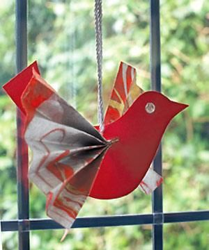 Hang pretty paper birds at the window. DIY by Allaboutyou.
