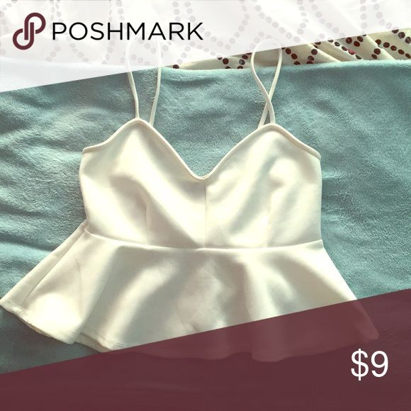 Love Culture white peplum top size small Great condition and so cute! I've gotten so many compliments on this top, it pairs really well with black bottoms or you can wear really bright colors with it and it looks great, make an offer!! Love Culture Tops Tank Tops