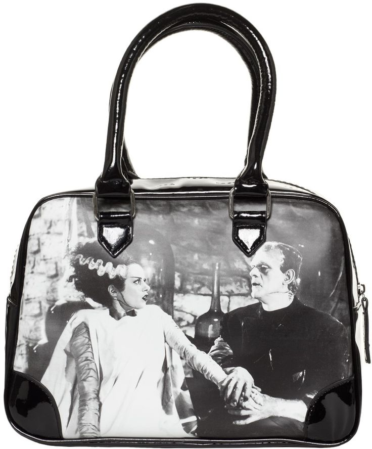 ROCK REBEL WE BELONG DEAD PURSE You will absolutely scream with delight when you see the We Belong Dead purse from Rock Rebel! This faux leather purse features Frankenstein & his Bride printed on both sides, shiny black vinyl top panel, shiny black vinyl handles & base, zip top with black & green striped lining inside. $42.00