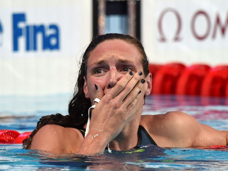 Katinka Hosszu of Hungary is overcome after winning the gold medal and setting a new world record in the 200-meter individual medley at the FINA World Championships in Kazan, Russia.  Matthias Hangst, Getty Images