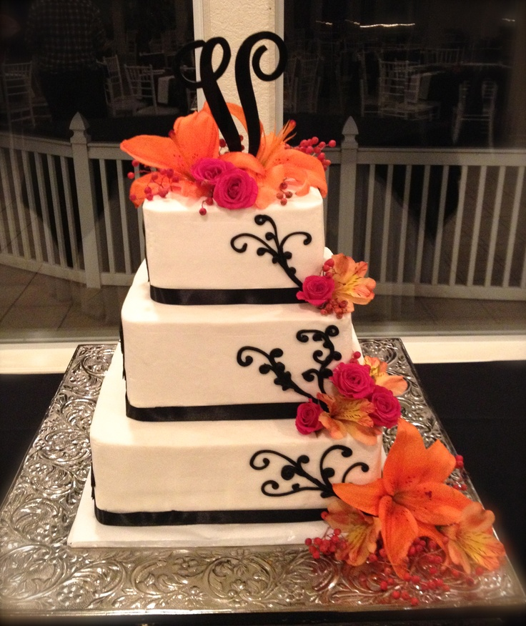 Orange lilies, pink mini roses and red pepper berries on 3 tiered square #wedding cake with black accent