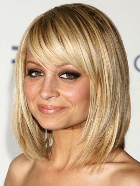 Sleek short blonde cut with swept bangs.