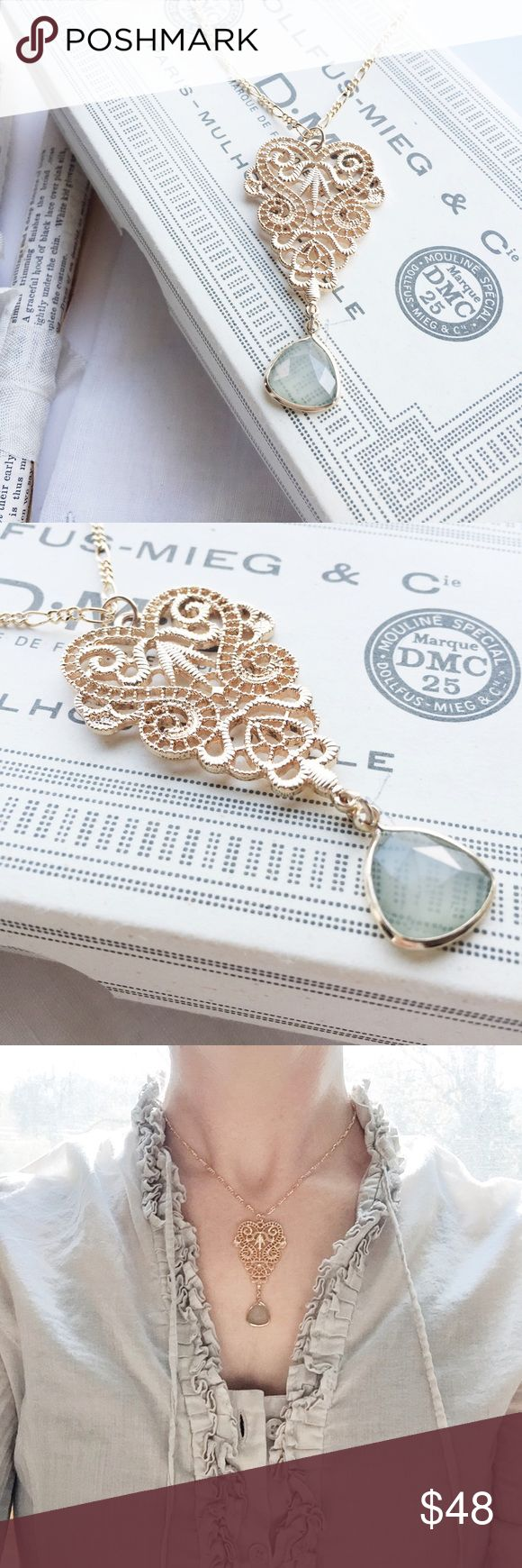 """gilded lace necklace Like a perfect specimen of lace, forever transformed into a gilded heirloom. So serene & lovely with a faceted aqua droplet and dainty link chain. Matte Gold.  Measures: hang length 