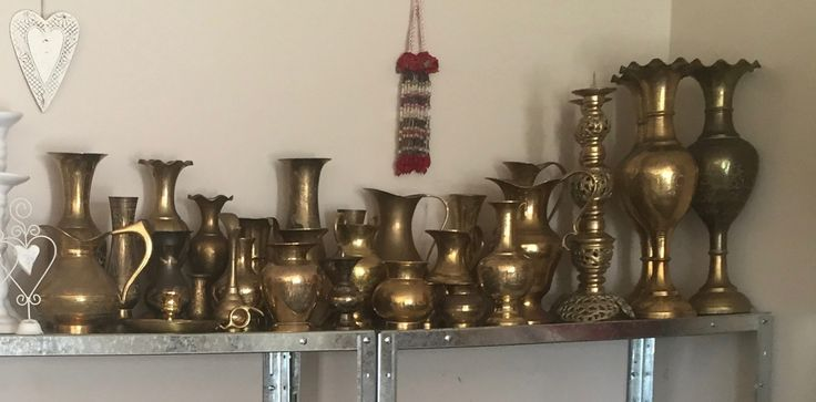 some of my collection of brass vases and candlesticks