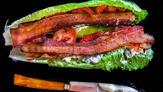 Carbless BLT  Ingredients  Wood smoked, high quality, thick cut bacon - if you are going to eat bacon, make it the good stuff Romaine lettuce leaves Ripe tomato slices Hellmann's Light Mayo
