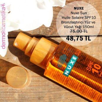 Nuxe Sun - Huile Solaire SPF10 - Bronzlaştırıcı Yüz ve Vücut Yağı 150ml Geniş spektruma sahip UVA ve UVB filtreleri sayesinde ideal koruma sağlar.  Su Sümbülü, cildi güneşin ısıtıcı etkisinden koruyan Kau Pe Çiçeği, foto-yaşlanmayı engellemeye yardım eden Pirinç, Biberiye ve Pancar özleriyle cildiniz bronzlaşırken de güzelliğini korur. Besleyici özelliklere sahip Macadamia, Shea ve Ayçiçek Yağları ise bronz görüntünüzü mükemmelleştirir. Yağlı his bırakmaz