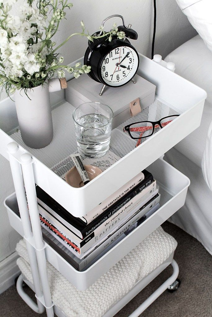 Use a mobile cart instead of a nightstand to maximize space in a tiny bedroom.