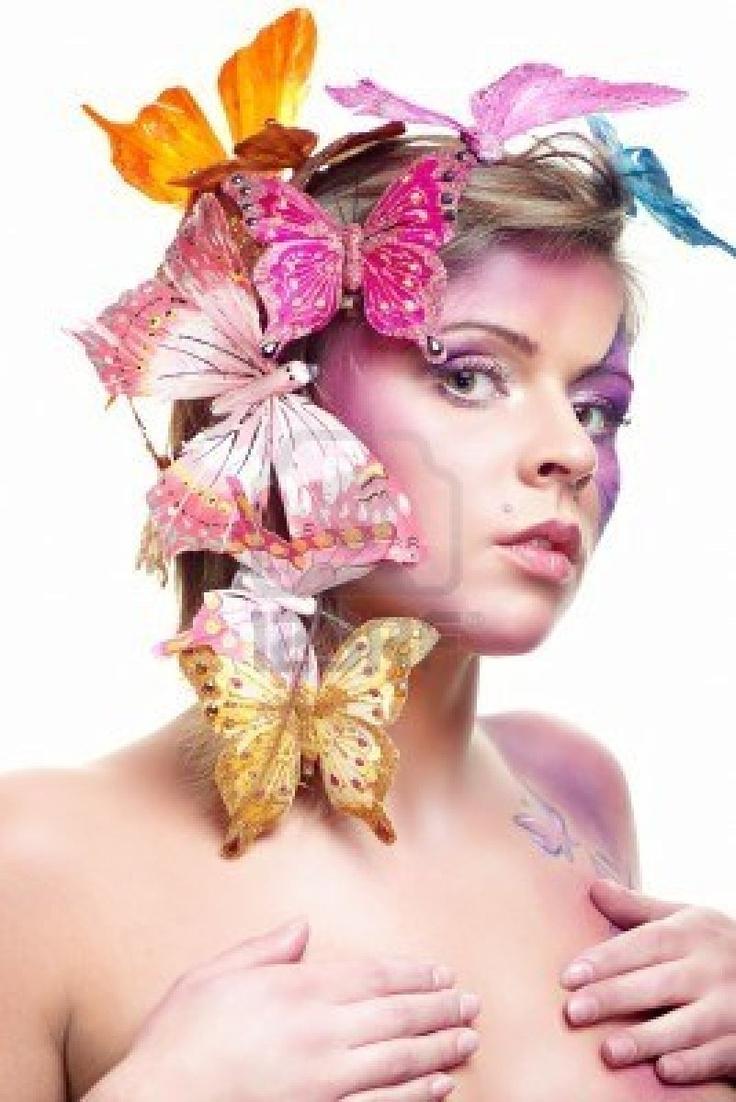 ファッションの肖像画の白、蝶の毛で分離された魅力的な若い美 ストックフォト - http://jp.123rf.com/photo_7941165_fashion-portrait-of-attractive-young-beauty-isolated-on-white-butterflies-in-hairs.html