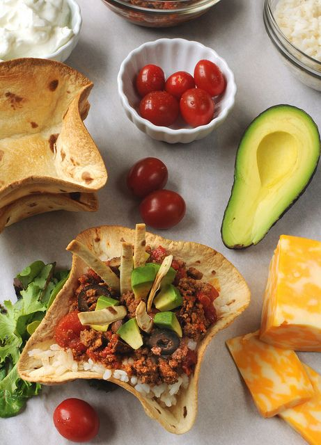 Texas Fiesta Bowls - includes directions on making your own taco bowls using tortilla shells baked in an upside down muffin tin