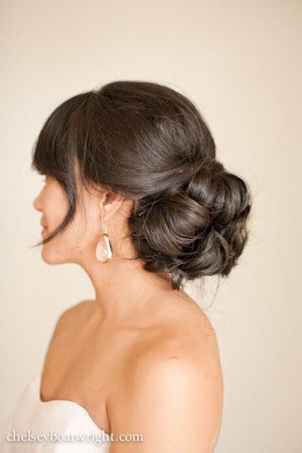 Wedding hair idea! Loose bun, leave bangs down, pieces falling on side.