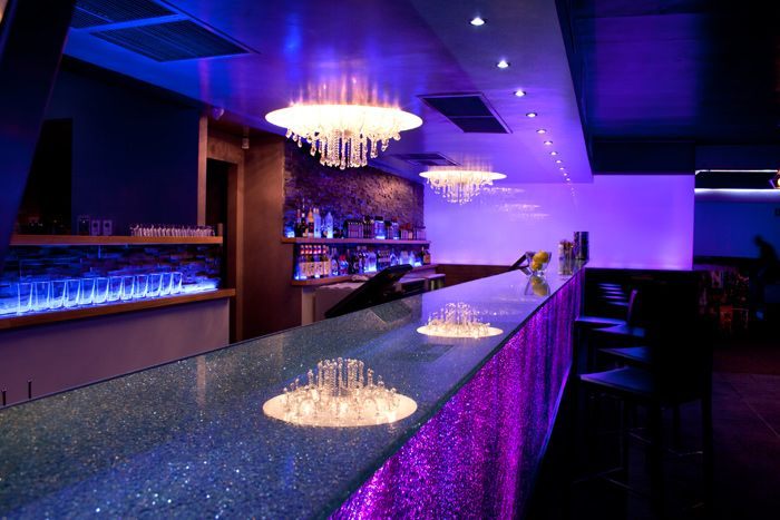 | LED colour changing counter fronts and low energy MR16 LED downlights  adorn the bar at Studio 557 |
