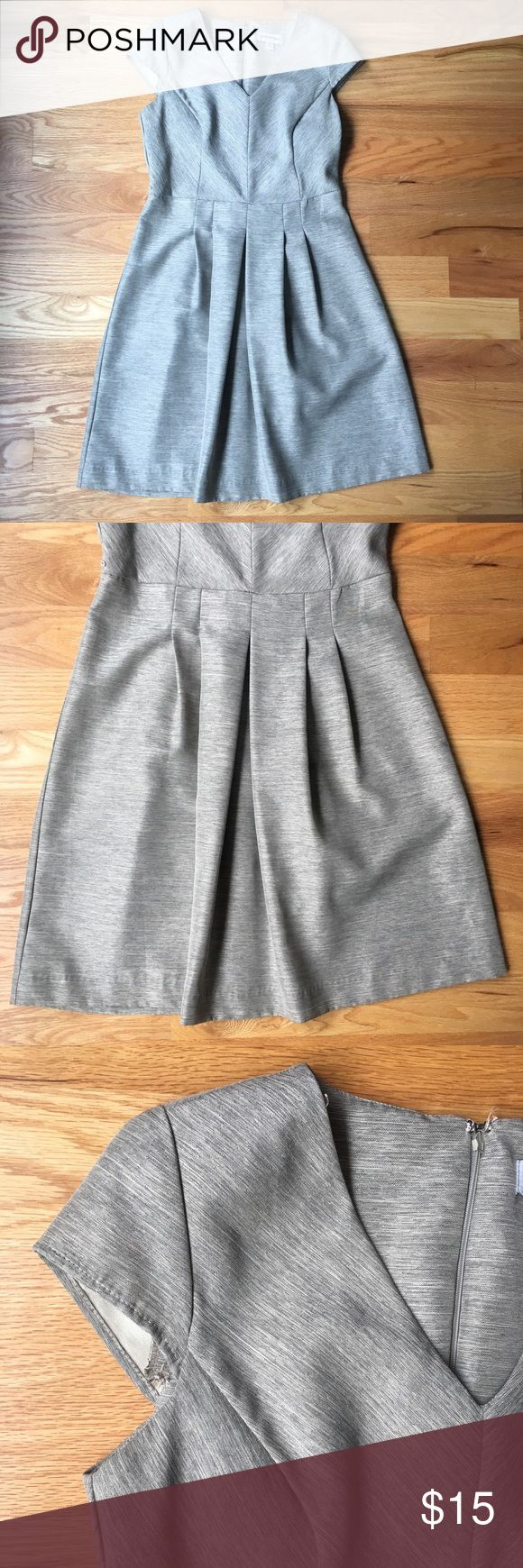 """Pleated gray dress About: · brand: Shelby & Palmer · size: 10 · pleated skirt · zips in the back · v-neck · very short capped sleeves · belt loops; belt is not included  Measurements: · bust: 36"""" · waist: 31"""" · length: 39""""  Flaws: · slight marking on the left side of skirt (right side when looking at the item) as seen in picture Shelby & Palmer Dresses"""