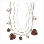 "Show the world your wild side with this ""purr""-fectly passionate charm necklace! Leopard-print hearts create a striking contrast against a cascade of silvertone chains and charms. Fashionable long necklace is a high-style look that's guaranteed to dazzle and delight even the most discerning fashion fanatic!"