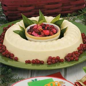 EGGNOG GELATIN MOLD with Cran  APPLE COMPOTE   -   3 envelopes unflavored gelatin  3/4 cup cold water  4 cups eggnog  1/4 cup Sugar  1/4 teaspoon ground nutmeg  1 cup heavy whipping cream
