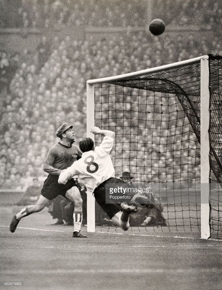 England inside-right Stan Mortensen (8) in mid-air as he heads the ball over the bar in an attack on The Rest of the World goal during the international football match in celebration of the 90th anniversary of the English Football Association at Wembey Stadium in London on 21st October 1953. The match resulted in a 4-4 draw.