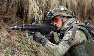 Soldier with Heckler & Koch G36 German military to stop using gun 'that can't shoot straight when hot'