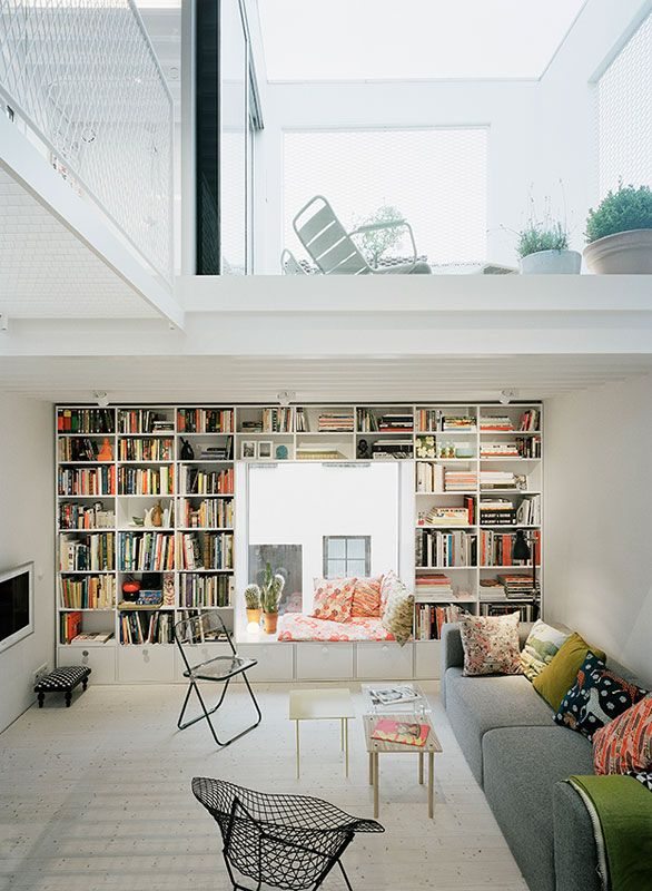 Living area with balcony above and cute window seat