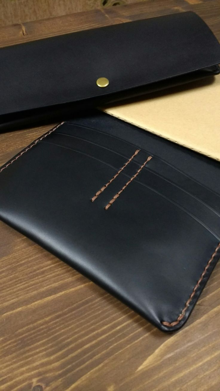 Moleskine notebook wallet in black vegetable tanned leather with brown linen thread.