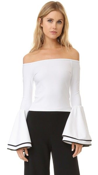 ¡Cómpralo ya!. Torn By Ronny Kobo Mimi Top - White. Contrast trim accents the layered bell sleeves on this Torn by Ronny Kobo crop top. Off shoulder neckline. Fabric: Ponte jersey. 60% rayon/33% nylon/7% lycra spandex. Dry clean. Made in the USA. Measurements Length: 12.5in / 32cm, from center back Measurements from size S. Available sizes: L,M,S,XS , tophombrosdescubiertos, sinhombros, offshoulders, offtheshoulder, coldshoulder, off-the-shouldertop, schulterfreiestop…