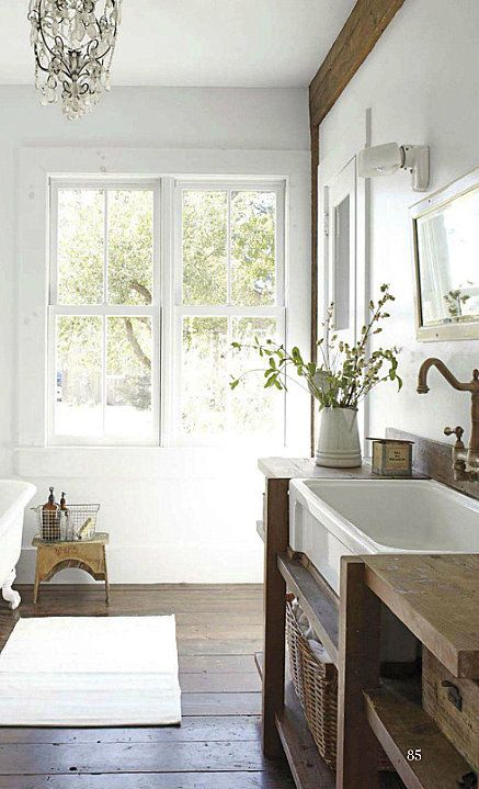 great bathroom. love the abundance of light, the over sized sink, the wood floor and the claw-foot tub that is just sneaking into the photo edge. PDH likes that the sink is big enough to give a baby or even toddler a bath in... :)