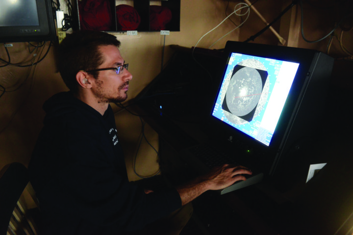 """The Return on Coast Guard Innovation  It's about the """"Coastie with the Idea."""":  Alex Balsley, a program manager with the Coast Guard Research and Development Center in New London, Connecticut, reads an ice radar display while underway in the Arctic aboard the CGC Healy Aug. 17, 2014. The Coast Guard was evaluating the system as part of its Arctic Strategy to test and refine the capabilities of Arctic resource requirements. U.S. Coast Guard photo by Petty Officer 1st Class Shawn Eggert"""