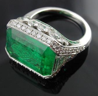 Edwardian horizontal set emerald cut emerald and diamond ring