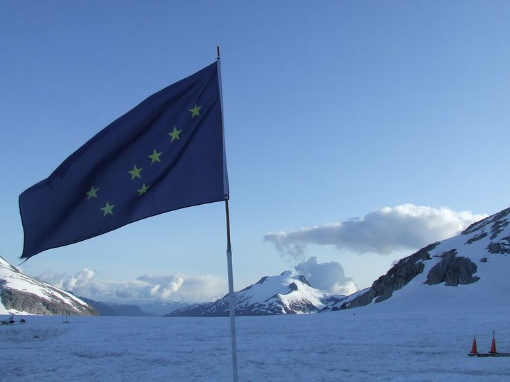 ALASKA: Alaska State Flag at Alaska Icefield Expeditions' Site on Mendenhall Glacier near Juneau
