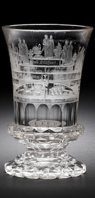 A North Bohemian engraved 'Lebensalter' beaker by Anton Simm, Gablonz, circa 1830 The flared campana form decorated with a terraced bridge, the underside of the bridge divided into two by an hourglass, Janus head and a ropetwist border, a coach and horses to the left inscribed Zur Taufe (To the Baptism), and six men carrying a coffin to the right inscribed Zum Grabe (To the Grave), the steps of the bridge surmounted by figures representing 'The Ages of Man', from a child in the cradle on the…
