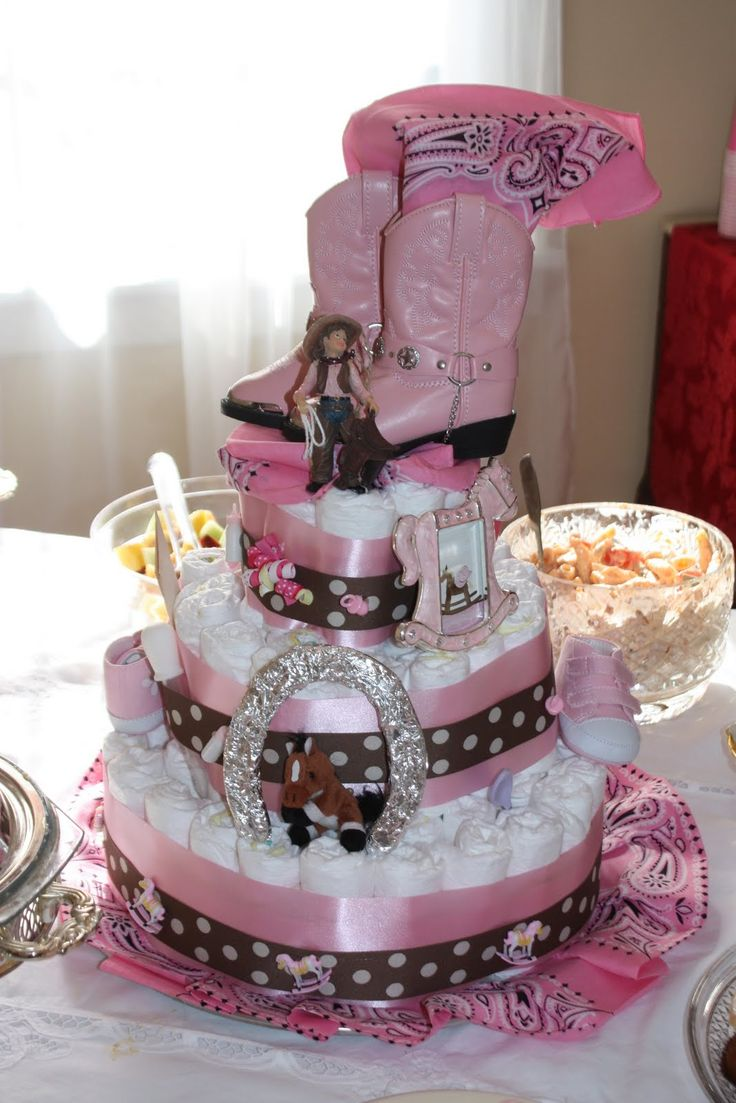 love this cake for the baby shower...too cute!  baby girl cowgirl boots.  This is a great diaper cake for a cowgirl baby shower theme.  http://www.modern-baby-shower-ideas.com/cowgirl-baby-shower.html