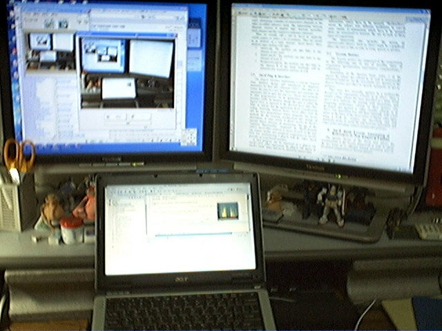 Laptop and two screens