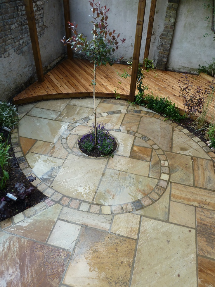 Nautilus paving design by trader ian webb gardens for Gardens with decking and paving