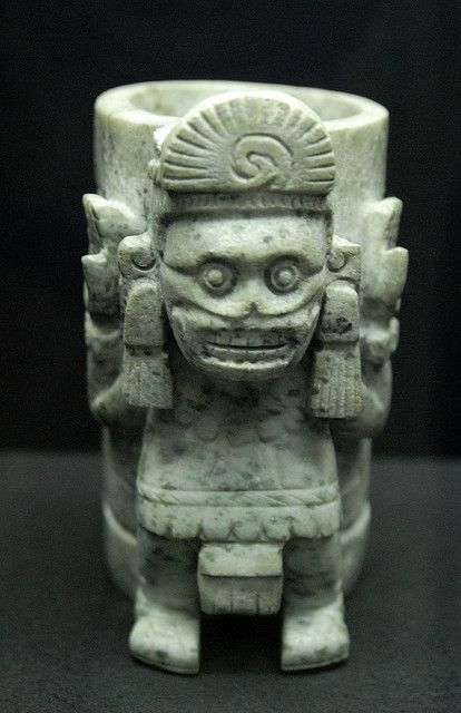 This vessel comes from the Aztec Templo Mayor museum in Mexico City. It seems to be an image of the death deity in female form wearing a skirt ski...