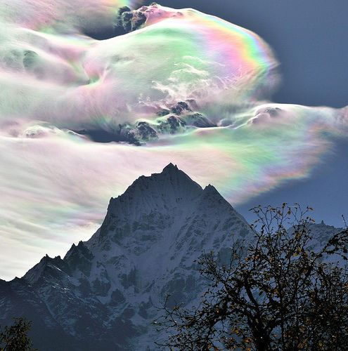 An Iridescent (Rainbow) Cloud in Himalaya by Oleg Bartunov: Turbulence, ice crystals in the low cloud and wonderful Himalaya produce this great picture. The mountain is Thamserku (6623 m). #Photography #Clouds #Rainbow #Himalayas