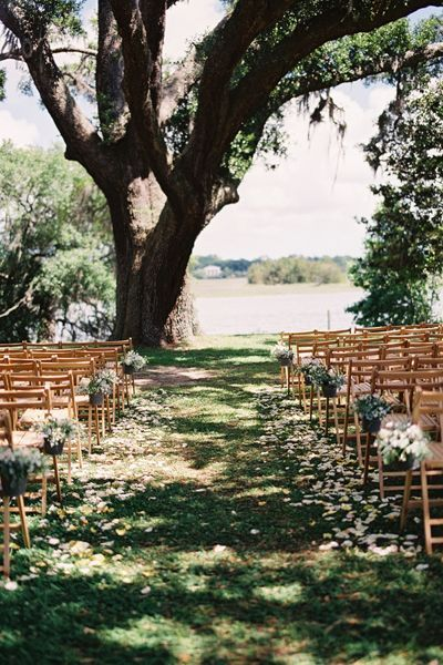 Beautiful petal-lined aisle | Loren Routhier #wedding