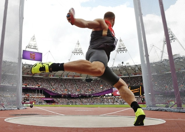 Germanys Robert Harting takes a throw in a mens discus throw qualification round during the athletics