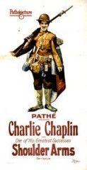 CINE(EDU)-736(3). ¡Armas al hombro!. Dir. Charles Chaplin. EEUU, 1918. Comedia. O soldado n. 13 do exército estadounidense da 1ª Guerra Mundial defende a fronte cos seus compañeiros. Charlot, convencido de que vai morrer por romper un espello, non acertar en cara ou cruz e por levar o 13 da mala sorte, sae cheo de medo, consegue capturar uns inimigos el só. Despois disto, cre que ten boa sorte, e decide facer un traballo voluntario. http://kmelot.biblioteca.udc.es/record=b1510753~S1*gag