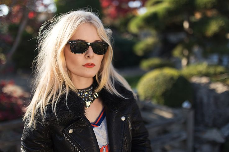 Christina Key is wearing a black Ray Ban sunglasses and a fake leather jacket