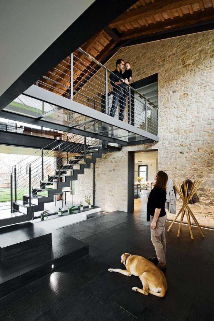 mezzanine railing, nice interior railing cables, natural stone wall